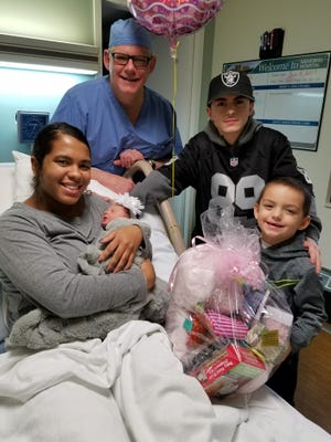 Baby Averie Ai'leen Wiezorek rests in her mother's arms at ProMedica Memorial Hospital in Fremont.