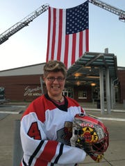 Injured firefighter Beth Csukas stands outside Swonder Ice Arena in September before the Guns & Hoses Hockey game. Csukas suffered a serious brain injury during a  January 2016 crash on Intestate 69, but has progressed quickly the last year. She will drop the first puck during another Evansville Hoses Hockey game in January. Proceeds from that game will go to the family of the 15-year-old Boonville girl who died in the crash last month.