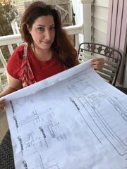 Amberly Larkins has not given up on her plans for a corner coffee shop at National and Central.