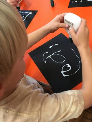 Draw a picture with glue, then use chalk to enhance it.