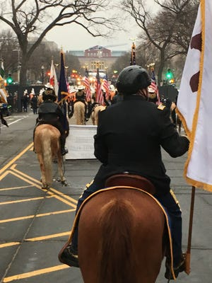 Livingston County Sheriff Mike Murphy had a front seat view of the Inaugural Parade, riding in a golf cart behind the Michigan Multi-Jurisdictional Mounted Police Drill team & Color Guard.