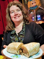 Kristina Groves of Evansville decided it was well worth a trip to Henderson if only for the 2 pound Medina's burrito.