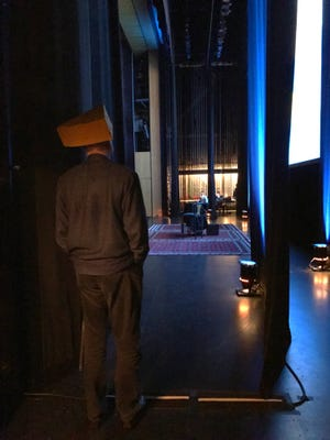 John Cleese has his Cheesehead on as he waits backstage at the Weidner Center to make his entrance before his appearance Monday night.