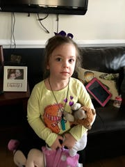 Lucy Rhoden, 5, has Dravet syndrome, a rare form of epilepsy. She experiences seven to eight seizures a month, some very severe.
