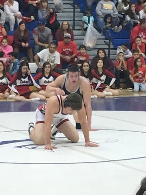 The match of Wednesday night came at 170 pounds. Armando Galindo of the Colts defeated Isiah Sifuentes of the Indians, 8-3. Above, Galindo prepares to take the top position against Sifuentes.