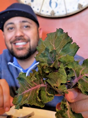 Jayson Muñoz of Kanpai and Commonwealth Kitchen and Bar with his favorite new vegetable--kalettes, a pretty cross between kale and brussels sprouts.