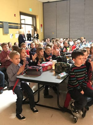 """Hershey Elementary students clap along to Bruce Barker """"The Piano Man's"""" musical talents on Tuesday during their """"Manners Lunch."""""""