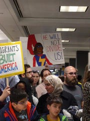 A sign with Ms. Marvel's likeness during a protest for President Trump's travel ban at Dulles Airport near Washington, D.C.