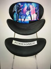This custom-made Foreigner chair, commissioned by billionaire businessman Tilman Fertitta, sold for $9,500 at a charity auction. It was made by the creators of Face Chairs in Naples.
