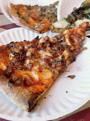 The toppings can be crazy on New York pizza -- in the front we have chicken and bacon, in center roast beef and mashed potato -- but they shouldn't be laid on too thick so as not to overwhelm the crust.