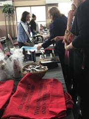 Attendees shop at the Susan B. Anthony luncheon 2017.