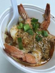 Bill Farina's shrimp and grits will go for four food tickets, or $5, at the Grant Seafood Festival, which will be March 4-5.