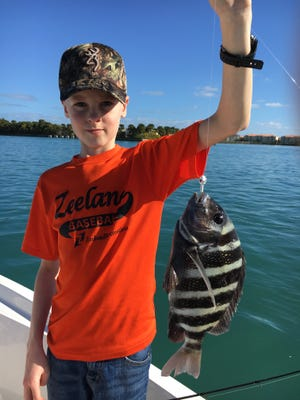 Colten with one of many sheepshead that was caught on an exciting morning on the Indian River