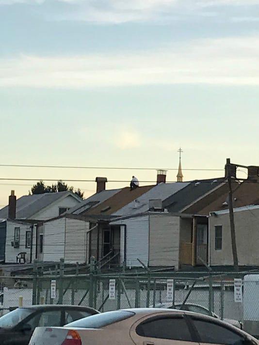 LDN-CJA-021717-Man on roof