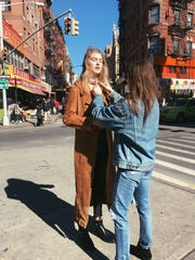 Natalie Washuta styling a model on the streets of new York.