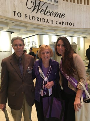Treasure Coast advocates John Winifree, Doris Sanders and Crystal Collier stand inside the Florida Capitol building during the Rally in Tally.