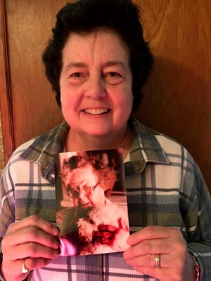 Gail McNiece holds a photo of her aunt, Barbara Church