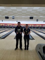 Cody Farr (left) and Kayla Jackson won the men's and women's individual singles regional trophies for Schoolcraft.