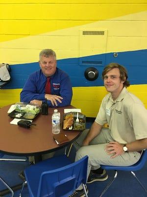 Democrat K-12 reporter Ryan Dailey with Fairview Middle School Principal Scott Hansen.