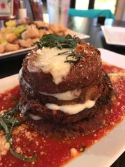 An eggplant stack is served in a pool of the Ferrari Pizza Bar's house red sauce.
