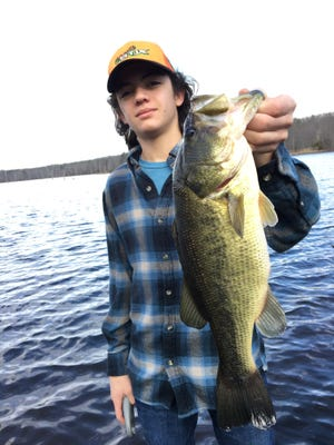 Anthony Lopardo holds a nice-sized largemouth bass he caught at a lake recently in Monmouth County.