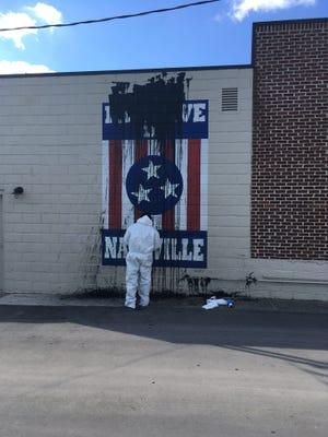 Nashville artist Adrien Saporiti's 12South mural was vandalized by black paint.