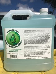A 2.5-gallon jug of 'Dr. Kirchner's Natural Weed Killer.' Rudy Kirchner fills each jug at the Fort Pierce Inlet and adds the other ingredients in his own back yard.