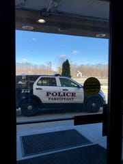 Police remove a man from the Parsippany Travelodge room on March 22.