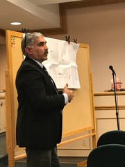 Berge Tombalakian of Boswell Engineering testifying Wednesday night on Ramsey's proposed community-senior center project.