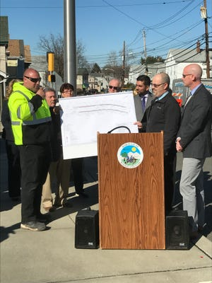 Woodland Park Borough and Passaic County officials speak during a press conference March 29 on McBride Avenue to announce the beginning of the McBride Avenue streetscape project in Woodland Park.