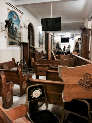 Pews are overturned inside the St. George Church after a suicide bombing, in the Nile Delta town of Tanta, Egypt, Sunday, April 9, 2017. Bombs exploded at two Coptic churches in the northern Egyptian cities of Tanta and Alexandria as worshippers were celebrating Palm Sunday, killing over 40 people and wounding scores more in assaults claimed by the Islamic State group.