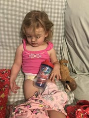 Isabella fell asleep sitting up with her favorite sippy cup. On this day, putting on pants was not an option.