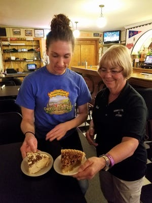 Hornville owner Deb Schneider and daughter Kate serve slices of their homemade peanut butter and pecan pies.