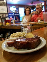 The Hornville Tavern serves a one-pound smoked bone-in chop that is a must-try. The meat is uncured and tastes like fresh pork, not ham, and the sauce is light and tangy.
