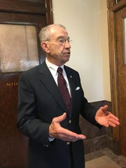 U.S. Sen. Chuck Grassley answers reporters' questions following a town meeting in Sigourney.