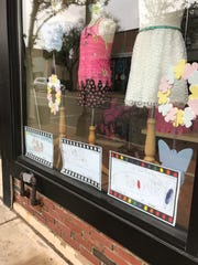 Film-related artwork by students of Nishuane School in Montclair decorates the storefront of Hip Chic on Bloomfield Avenue.