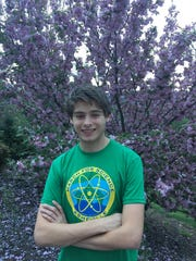 North Buncombe High School senior Luke Shealy organized the first Asheville March for Science.