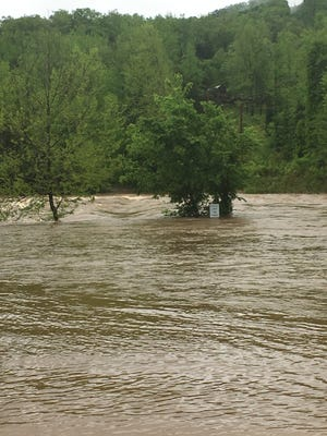 About 5 feet of water was flowing over the low-water bridge at Ponca at 2 p.m. Wednesday. The river normally is safe to paddle when water is flowing underneath the bridge.