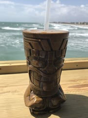 Rikki Tiki Tavern at the Cocoa Beach Pier serves tropical drinks from a perch above the Atlantic.