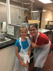 Amanda Johnson and her daughter Addie volunteer at