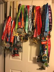 Darla Dennis of Carmel has a large collection of medals from 99 half-marathon races.