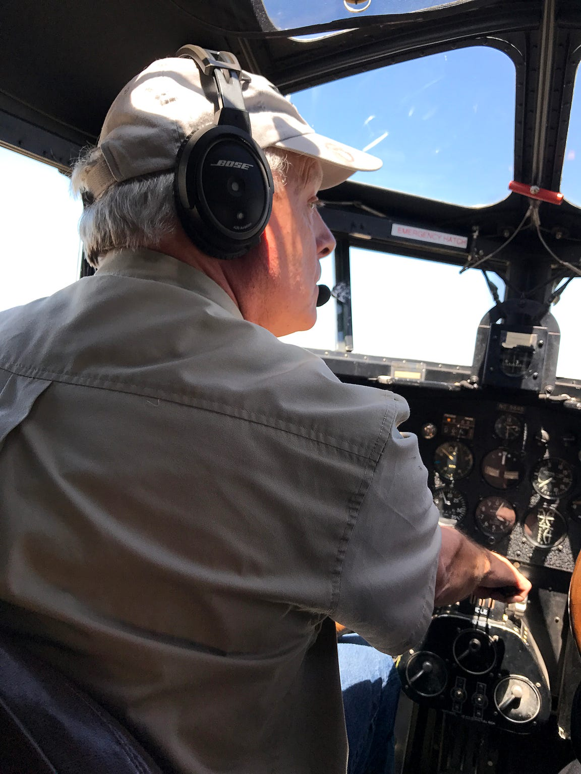 Pilot Bill Sleeper looks over to check his gauges during a flight over Abilene in the 1928 Ford Tri-Motor on Thursday, May 4, 2017.