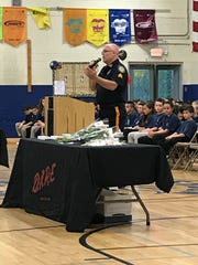 Ringwood Police Sgt. Henry Hill speaks during the town's D.A.R.E. graduation on May 4, 2017.