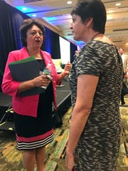 State Sen. Kathleen Passidomo, left, talks with an attendee after the Wake Up Naples breakfast May 10, 2017.