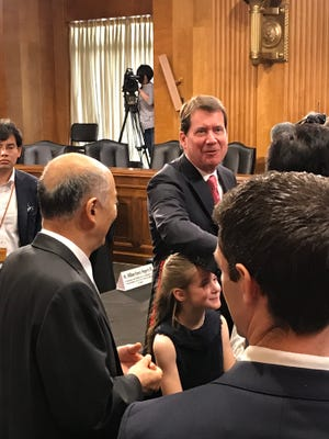 Nashville businessman Bill Hagerty greets well wishers after his hearing before the Senate Foreign Relations Committee to be ambassador to Japan