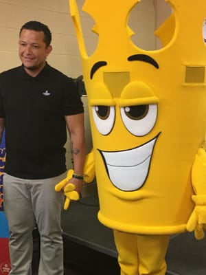 Tigers first baseman Miguel Cabrera poses with his mascot for his new candy, bitbits, Friday at Comerica Park.