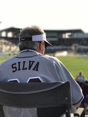 Retiring MSU equipment manager Phil Silva watched a game from the top of his milk truck for the final time Saturday.