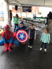Isabella Bielak (right) and Coen Fox grab a photo op with Captain America and Spiderman.