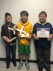"Team Fly Returner, from left, Anai Moua, Yeezong ""Simon"" Thao and Justin Xiong designed a cardboard boomerang. The D.C. Everest seventh-grade team took first place at the state STEM competition."
