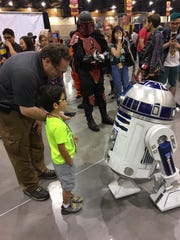 R2D2 meets with fans at the Star Wars Neighborhood